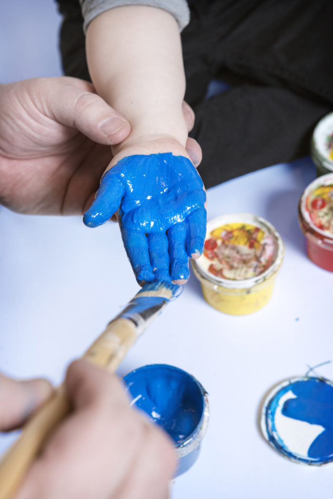 blue-hand-kid-painting